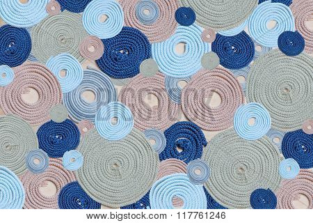 Abstract Background With Rolled Up Cords In Several Colors