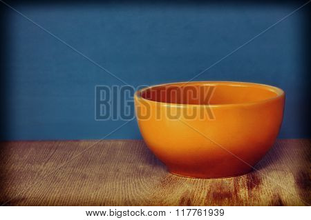 Ceramic Plate, Soup Tureen On Wooden Surface Against Of Blue Background.
