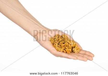 Nuts And Cooking Theme: Man's Hand Holding A Fresh Peeled Walnuts Isolated On A White Background In