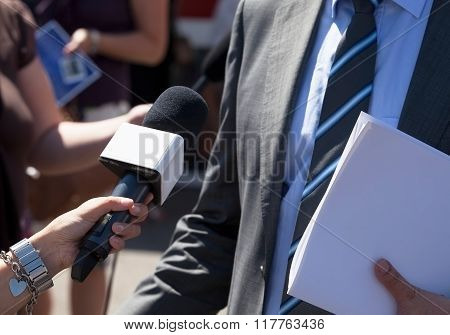 Journalist making media interview with businessman
