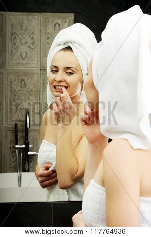 Woman take care of her teeth.