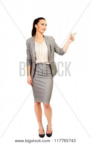 Businesswoman pointing up.