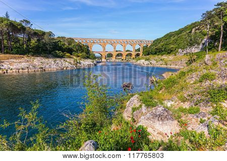 Three-tiered aqueduct Pont du Gard - the highest in Europe.  Provence, spring sunny day. The bridge was built in Roman times on the river Gardon