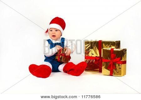 Happy Little Boy In Santa Hat With A Bunch Of Gifts, Holiday Christmas, New Year