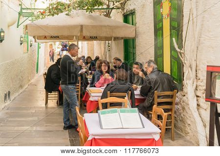 Nafplio, Greece 27 December 2015. Traditional tavern at Nafplio in Greece with people.