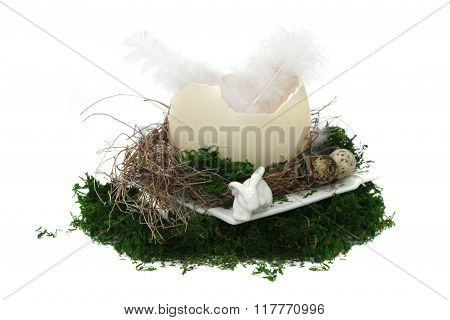Easter nest with eggs, rabbit and moos on white background