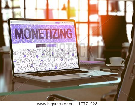 Monetizing Concept on Laptop Screen.