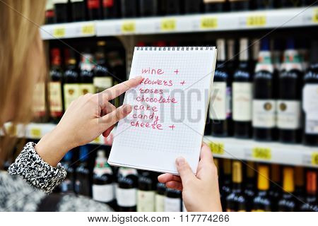Girl Chooses Wine For Date In Store