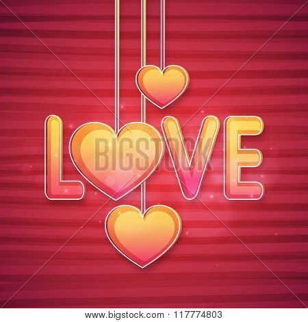 Shiny colorful text Love with hanging hearts on abstract background for Happy Valentine's Day celebration.