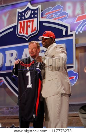 Marcell Dareus (R) is introduced by Commissioner of the National Football League Roger Goodell as the third pick to the Denver Broncos at the NFL Draft 2011 at Radio City Music Hall in New York, NY.
