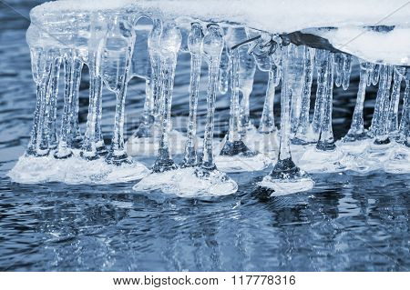 Icicles over water