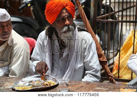 Pune, India  - july 11, 2015: A Hindu Pilgrim Having A Meal Served To Him By A Charitable Organiza