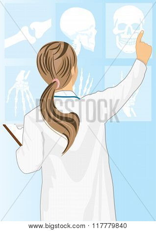 Medical doctor woman pointing on tomography