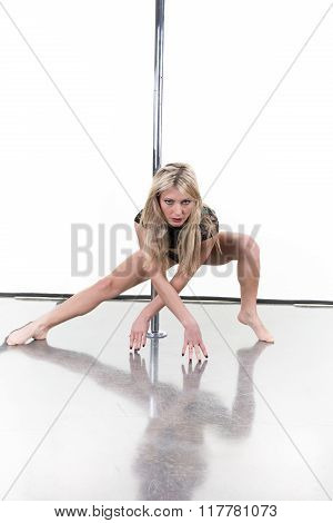Attractive Young Woman On The Floor In Pole Fitness Class