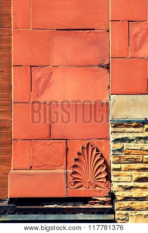 Background image shows three different kinds of bricks. The red is a locally mined sandstone found in the Upper Peninsula Michigan.
