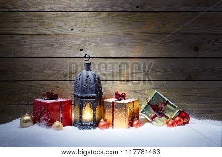 Christmas Gifts With Lantern In Snow