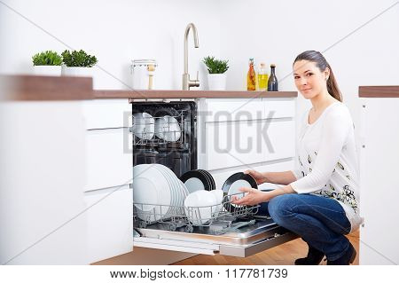 20S Woman In Kitchen, Empty Out The Dishwasher 3