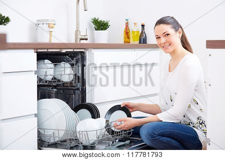 20S Woman In Kitchen, Empty Out The Dishwasher 5