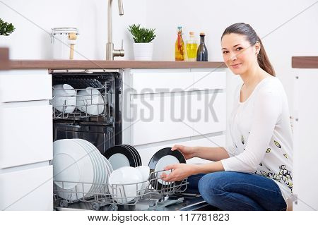 20S Woman In Kitchen, Empty Out The Dishwasher 6