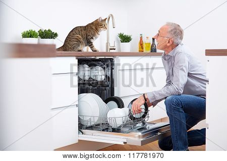 Senior Man With Cat In Kitchen 2