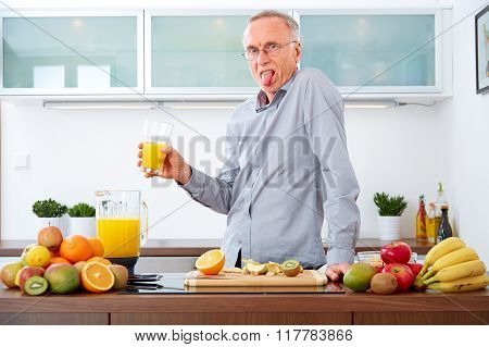 Senior Man Does Not Like To Drink His Juice