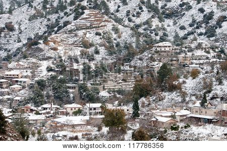 Winter mountain landscape with snow at the village of Kakopeetria at Troodos Mountain range in Cyprus.