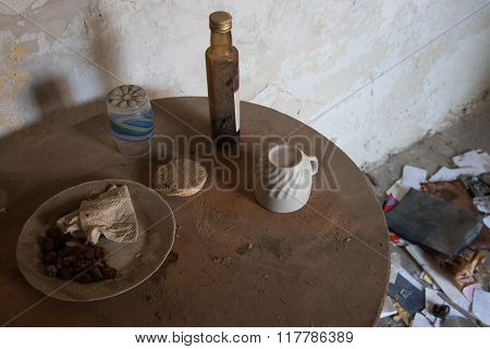 Abandoned House kitchen with leftover food and drinks on the table