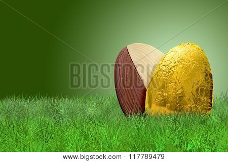 Golden Easter egg and double taste Easter egg on on grass on green background