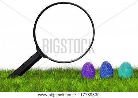 Loupe searching Easter eggs on grass on white background - Easter hunt