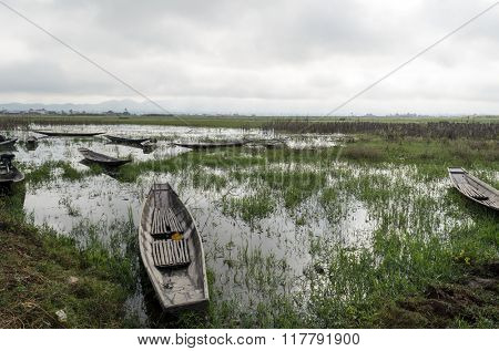 Old long boat on Inle lake, Shan State, Myanmar (BURMA). This is a traditional  transport in this area.