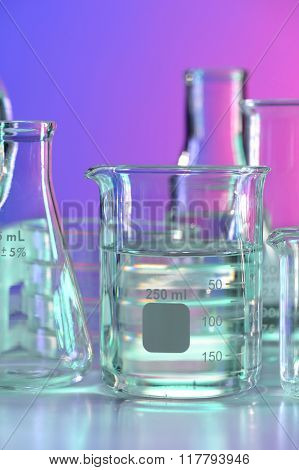 BEaker with clear fluid on laboratory table