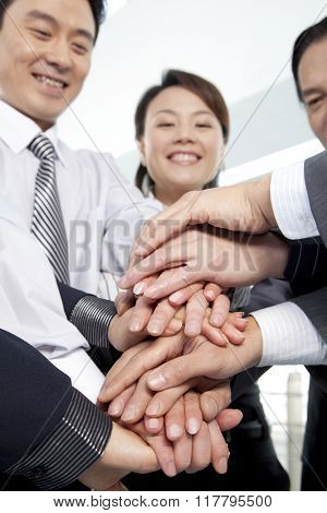 Business Team Making a Hand Pile