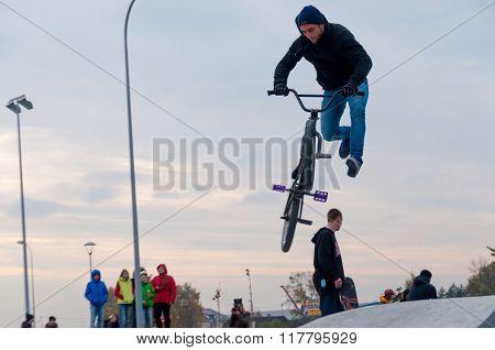 Sportsman doing trick on BMX