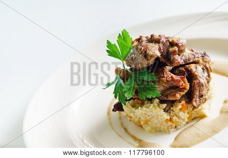 meat served with  millet