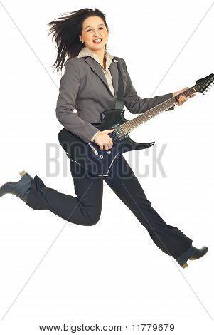 Jumping Executive Woman With Guitar