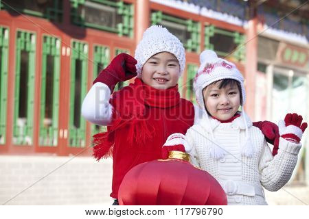Children holding red lantern