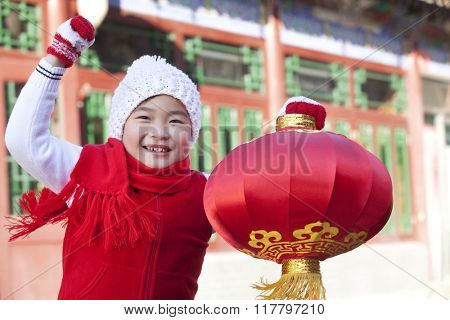 Young boy holding red lantern