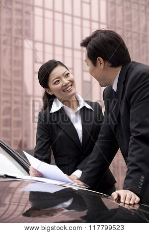 Two businesspeople working together outdoors