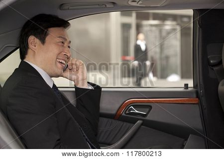 businessman making phone call in the car