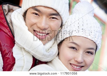 Young couple holding red lantern