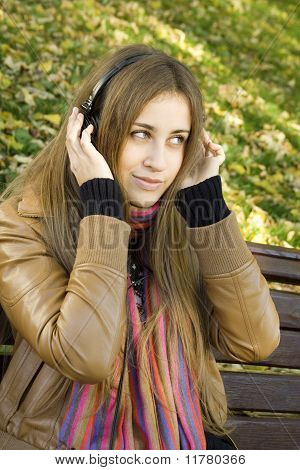 Young woman with headphones in the park