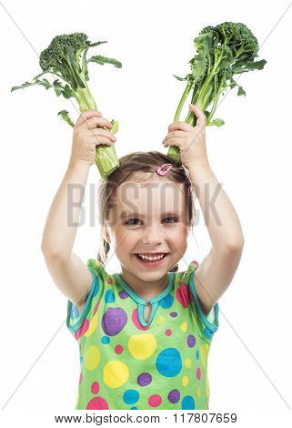 Little girl holding two broccoli