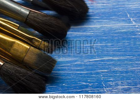 Painting tools colour palette and Artist paint brushes on abstract artistic background