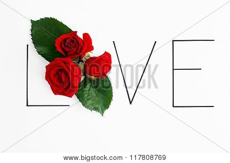 Inscription love with red roses on white background