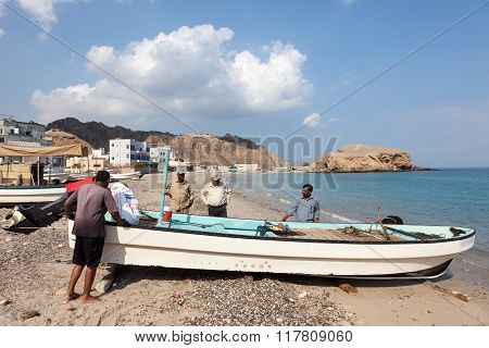Omani Fishermen With Their Boat