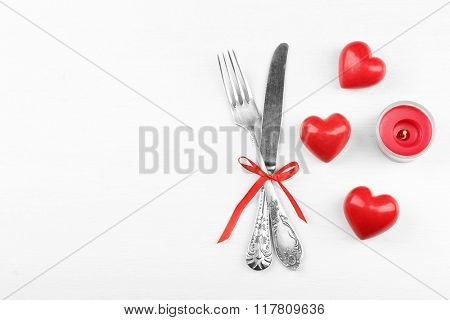 Concept of festive table setting for Valentines Day on light background