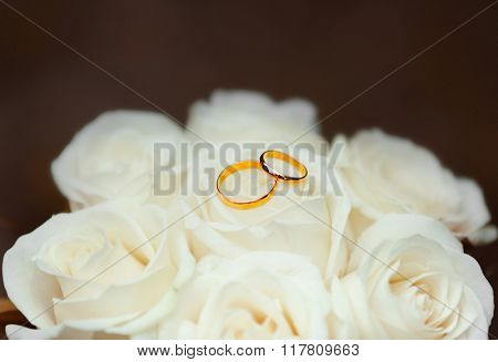 Beautiful bouquet with wedding rings