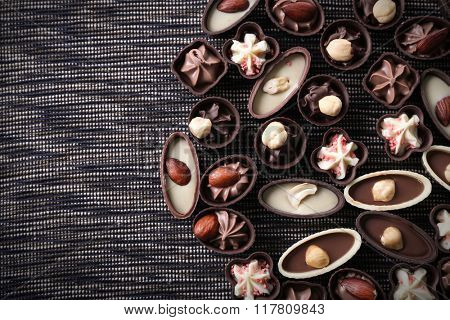 Chocolate sweets on fabric background