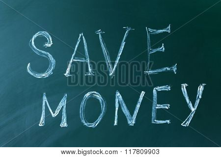 Save money concept on a blackboard background