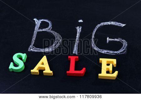 Big sale concept on a blackboard background
